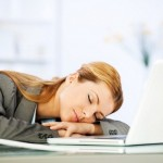 Tired young woman napping in the office leaning on the table.   [url=http://www.istockphoto.com/search/lightbox/9786622][img]http://dl.dropbox.com/u/40117171/business.jpg[/img][/url]